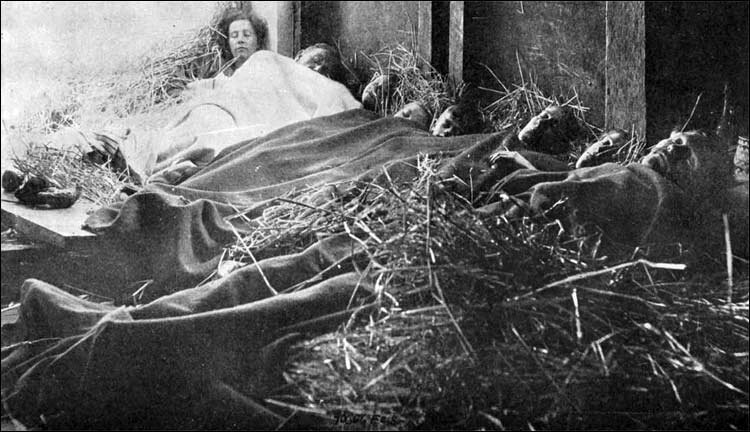 Belgian refugees sleeping in straw