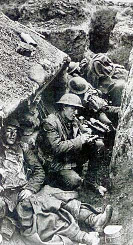 Writing a letter in a trench in the Great War